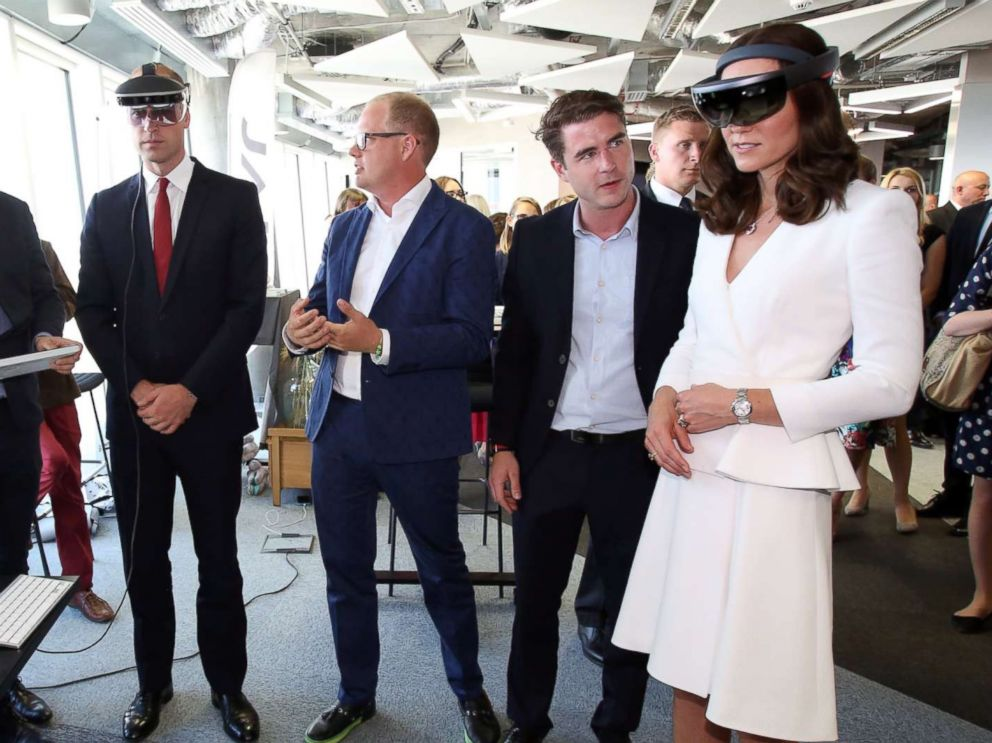 PHOTO: Britains Prince William and Duchess Catherine look through a virtual reality goggles as they meet with young Polish entrepreneurs at the Heart business incubator in the Warsaw Spire building in Warsaw, Poland, July 17, 2017.