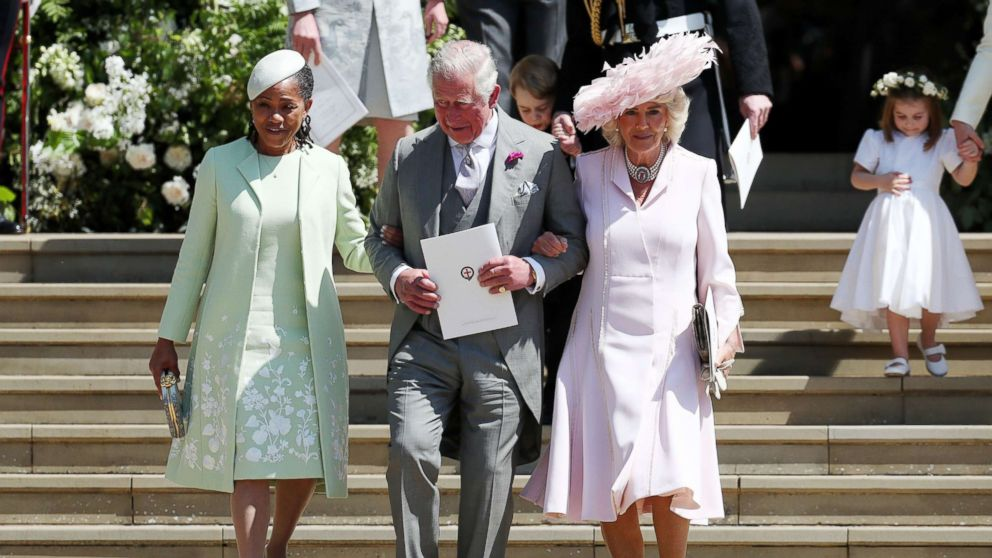 Doria Ragland, mother of the bride, Prince Charles, Prince of Wales and Camilla, Duchess of Cornwall walk down the steps at Windsor Castle after the wedding of Prince Harry and Meghan Markle, May 19, 2018.