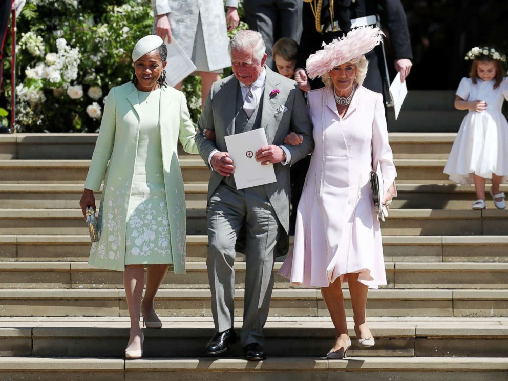 PHOTO: Doria Ragland, mother of the bride, Prince Charles, Prince of Wales and Camilla, Duchess of Cornwall walk down the steps at Windsor Castle after the wedding of Prince Harry and Meghan Markle, May 19, 2018.