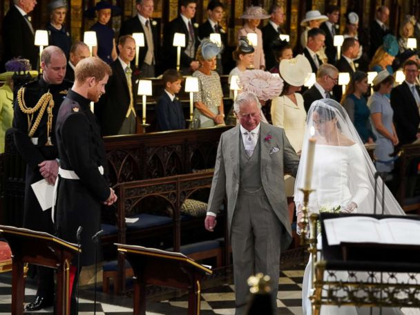 The unforgettable moment Prince Charles walked Meghan Markle down the aisle