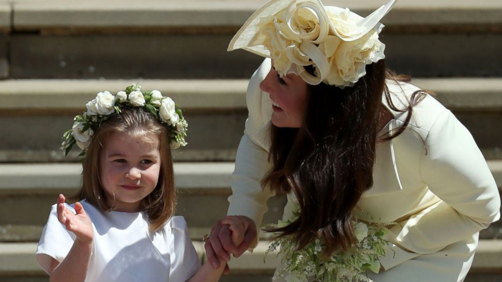 Princess Charlotte waves by her mother Britain's Catherine, Duchess of Cambridge after attending the wedding ceremony of Britain's Prince Harry and Meghan Markle at St George's Chapel in Windsor, May 19, 2018.
