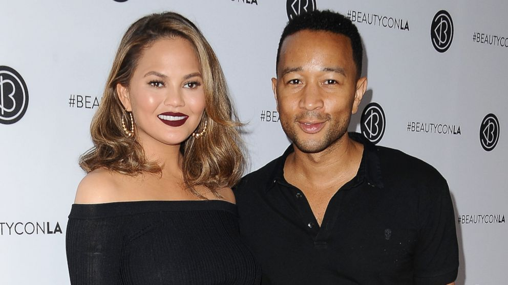 Chrissy Teigen and John Legend attend the 5th annual Beautycon festival at Los Angeles Convention Center, Aug.13, 2017, in Los Angeles.