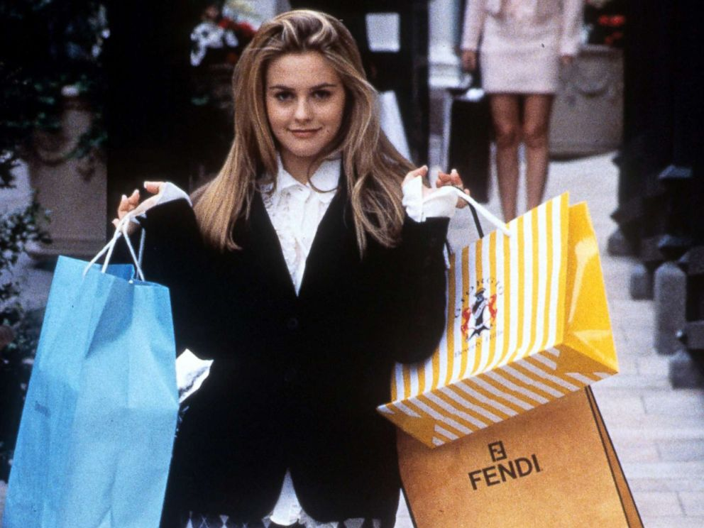PHOTO: Alicia Silverstone holds shopping bags in a scene from the film Clueless, 1995.