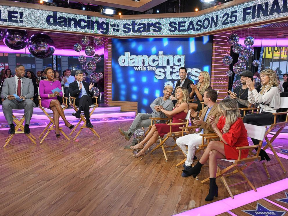 PHOTO: Fisher and the remaining contestants -- Lindsey Stirling and Mark Ballas, Frankie Muniz and Witney Carson and Drew Scott and Emma Slater -- all traveled from Los Angeles overnight to join GMA in Times Square.