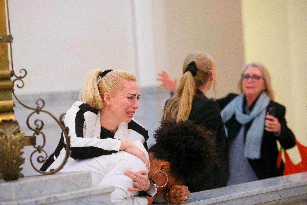 PHOTO: Bill Cosby accusers, from left, Caroline Heldman, Lili Bernard and Victoria Valentino, right, react outside the courtroom after Cosby was found guilty in his sexual assault retrial, April, 26, 2018.
