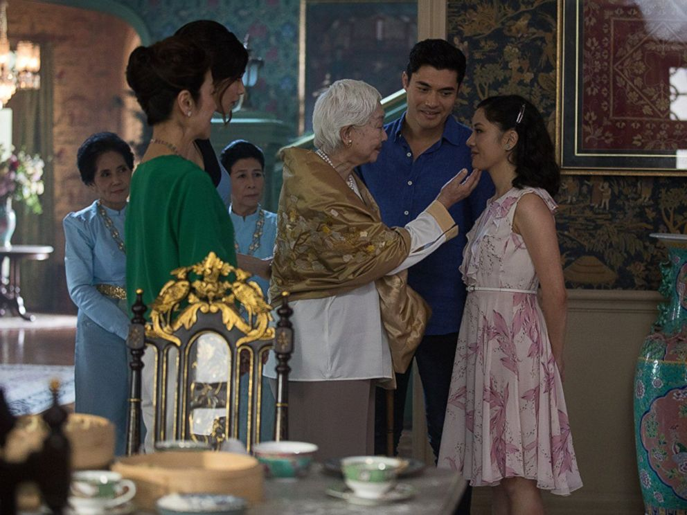 PHOTO: Michelle Yeoh, Constance Wu, Gemma Chan, and Henry Golding in a scene from Crazy Rich Asians, 2018.