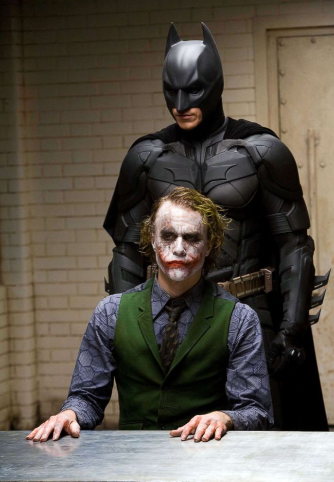 "Christian Bale, as Batman, back, and Heath Ledger, as Joker, in a scene from ""The Dark Knight."""