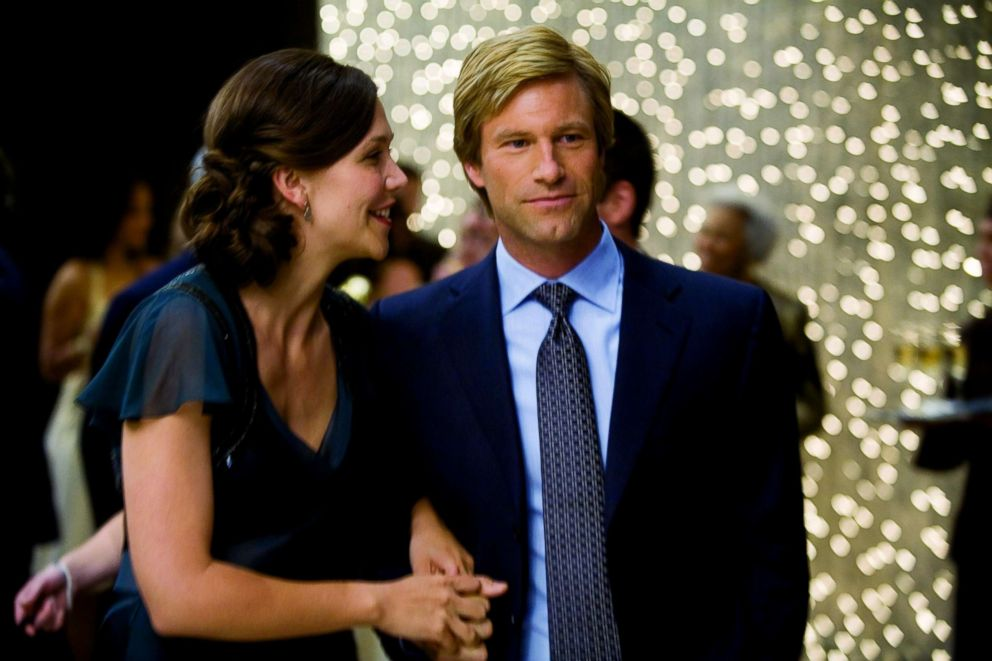 """Maggie Gyllenhaal, as Rachel, and Aaron Eckhart, as Harvey Dent, in a scene from """"The Dark Knight."""""""