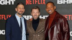 'PHOTO: David Ayer, Joel Edgerton and Will Smith attend the European Premeire of' from the web at 'https://s.abcnews.com/images/Entertainment/david-ayer-joel-edgerton-will-smith-gty-ml-171221_16x9t_240.jpg'