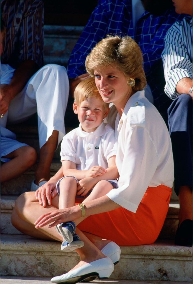 PHOTO: Diana, Princess Of Wales, sits on the steps of the Marivent Palace in Palma, Spain with Prince Harry on Aug. 13, 1988.