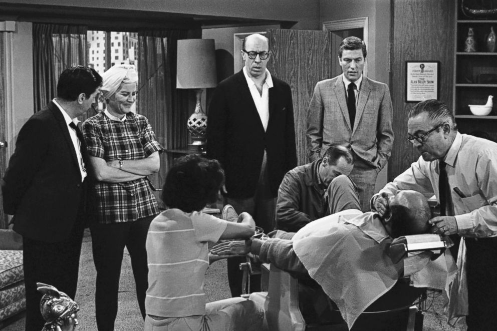 "PHOTO: From left, Morey Amsterdam, Rose Marie, and Richard Deacon, and Dick Van Dyke, right, gather around Carl Reiner, in barber chair, during a rehearsal of an episode for the ""The Dick Van Dyke Show,"" on April 11, 1963."