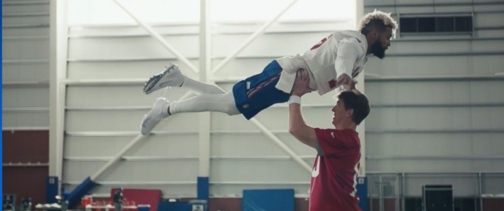 "PHOTO: The NFL premiered its new TV commercial starring Eli Manning and Odell Beckham Jr. at Super Bowl LII, Feb. 4, 2018, where the two recreated the dance scene from the film ""Dirty"