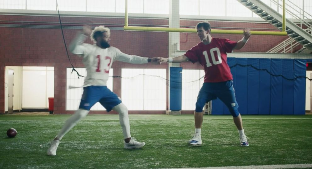 PHOTO: The NFL premiered its new TV commercial starring Eli Manning and Odell Beckham Jr. at Super Bowl LII, Feb. 4, 2018, where the two recreated the dance scene from the film Dirty