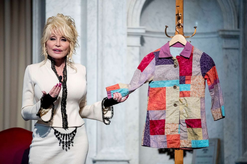 PHOTO: Dolly Parton speaks at an event where her organization, Imagination Library, donates the 100 millionth book, Dolly Partons Coat of Many Colors, to the Library of Congress collection, Feb. 27, 2018 in Washington.