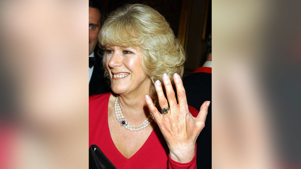 Camilla Parker Bowles shows off her engagement ring as she and Prince Charles arrive for a party at Windsor Castle after announcing their engagement earlier on Feb. 10, 2005.