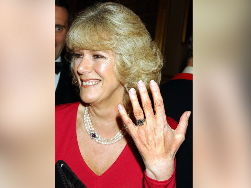 PHOTO: Camilla Parker Bowles shows off her engagement ring as she and Prince Charles arrive for a party at Windsor Castle after announcing their engagement earlier on Feb. 10, 2005.