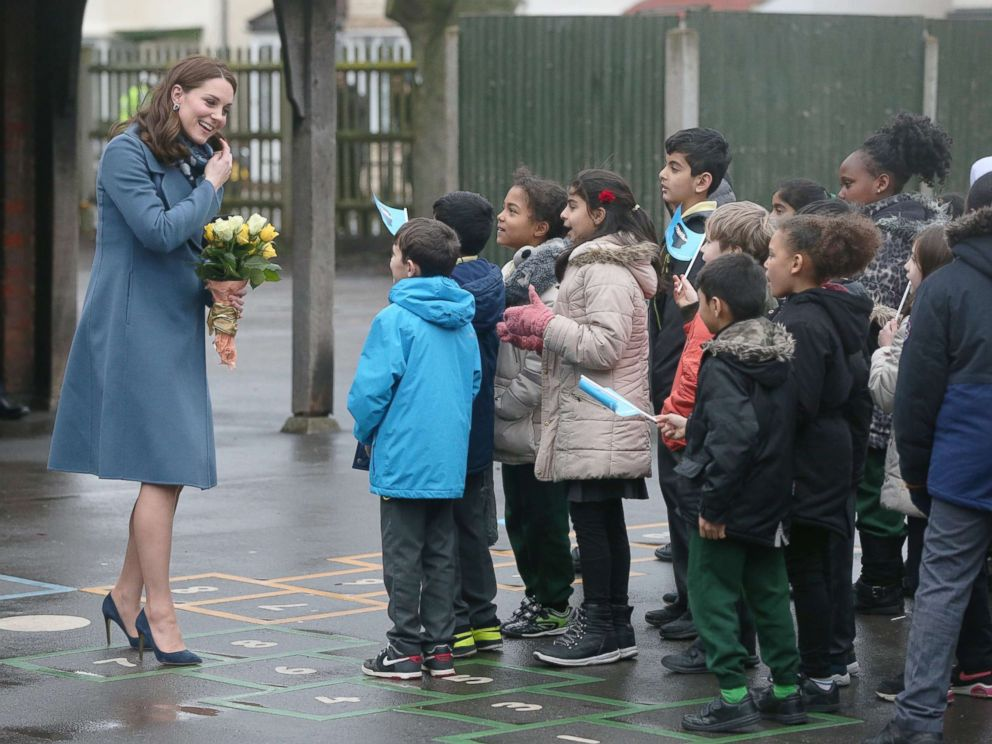 PHOTO: The Duchess of Cambridge greets children as she arrives at Roe Green Junior School where she will launch a mental health program for schools, Jan. 23, 2018, in Brent, London.