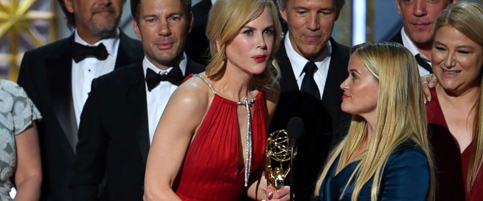 "PHOTO: Nicole Kidman (C), Reese Witherspoon (R), and the cast and crew of ""Big Little Lies"" accept the award for Outstanding Limited Series for ""Big Little Lies"" onstage during the 69th Emmy Awards, Sept. 17, 2017, in Los Angeles."