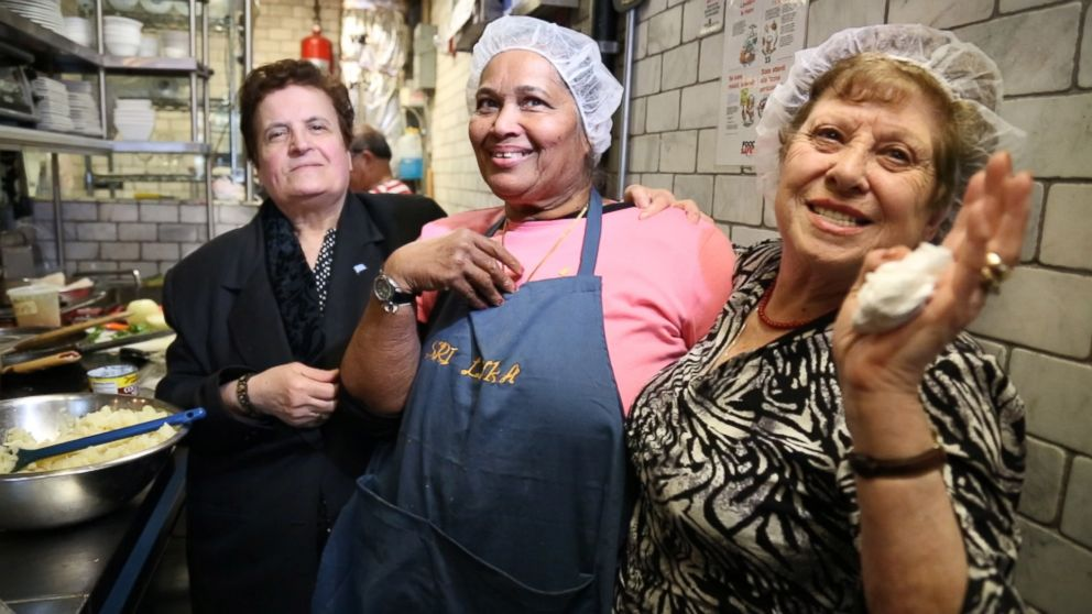 PHOTO: From left to right, Ploumitsa Zimnis, May Dolly Joseph and Maria Giannella, cook together in the kitchen of Enoteca Maria restaurant in New York City.