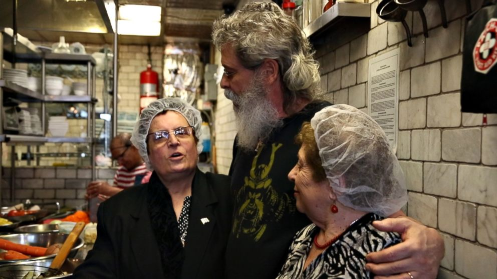 PHOTO: Jody Scaravella, center, is photographed with Ploumitsa Zimnis, left, and Maria Giannella at Enoteca Maria, a restaurant he owns in New York City.