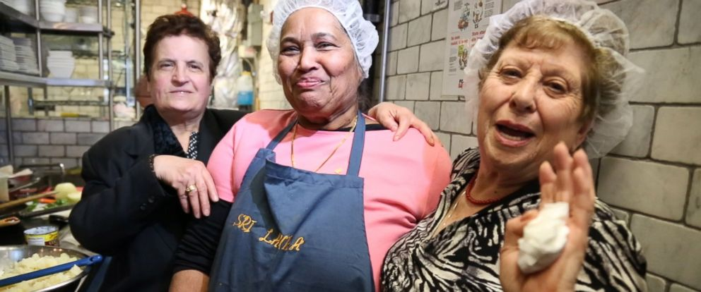 """PHOTO: From left to right, Ploumitsa Zimnis, May """"Dolly"""" Joseph and Maria Giannella, cook together in the kitchen of Enoteca Maria restaurant in New York City."""