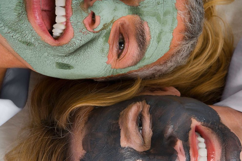 PHOTO: Two women are pictured smiling and wearing facial masks in this undated stock photo.