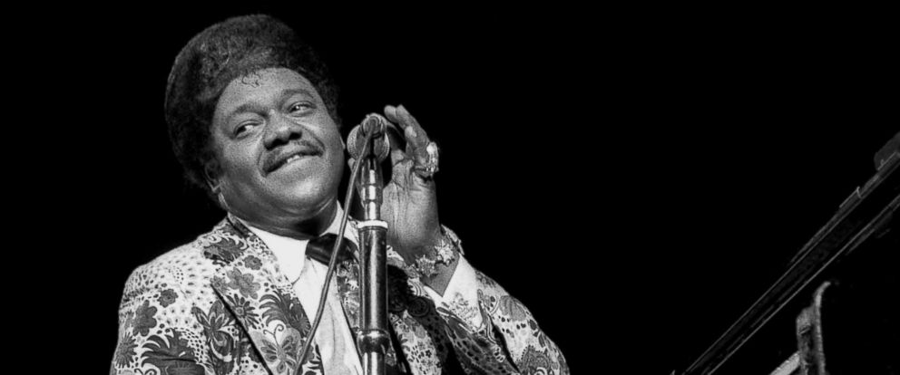PHOTO: Rhythm and blues singer-songwriter and pianist Fats Domino performs at the Hammersmith Odeon on March 19, 1978 in London.