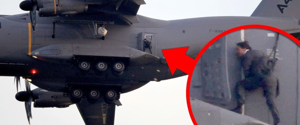 PHOTO: Actor Tom Cruise hung onto the tail of the Airbus A400 M as it flew above the British countryside at 5,000 feet as part of a dangerous and ambitious stunt as he films Mission Impossible 5.