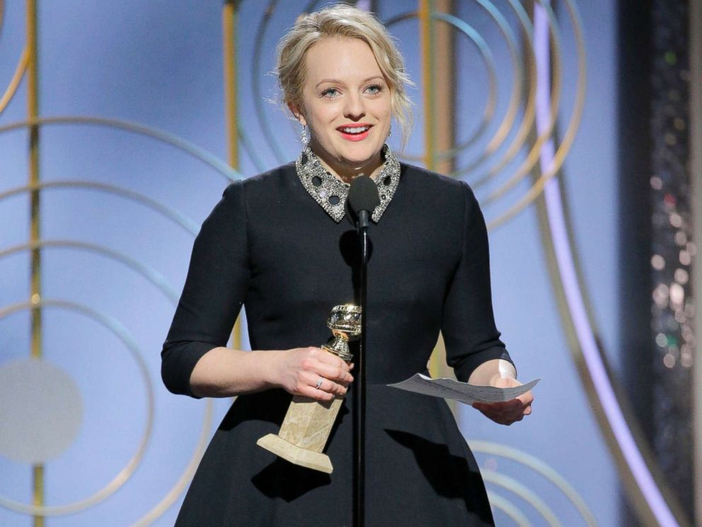 PHOTO; Elisabeth Moss accepts the Golden Globe for her role in The Handmaids Tale, Jan. 7, 2018, at the 75th annual Golden Globe Awards in Beverly Hills, Calif.