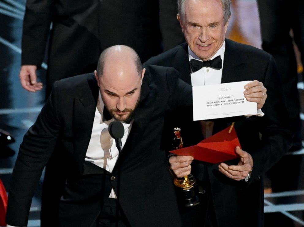 PHOTO: La La Land producer Jordan Horowitz holds up the winner card reading actual Best Picture winner Moonlight as Warren Beatty and Jimmy Kimmel look on during the 89th Annual Academy Awards on Feb. 26, 2017 in Hollywood, Calif.