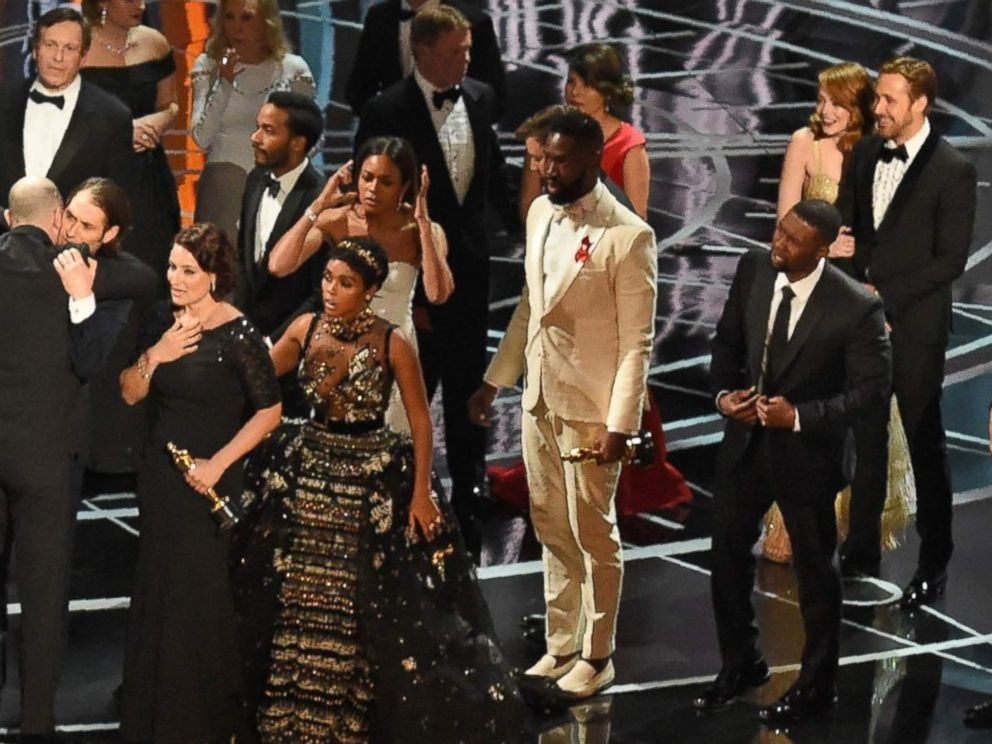 PHOTO: The cast of Moonlight and La La Land appear on stage as presenter Warren Beatty shows the winners envelope at the 89th Oscars on Feb. 26, 2017 in Hollywood, Calif.