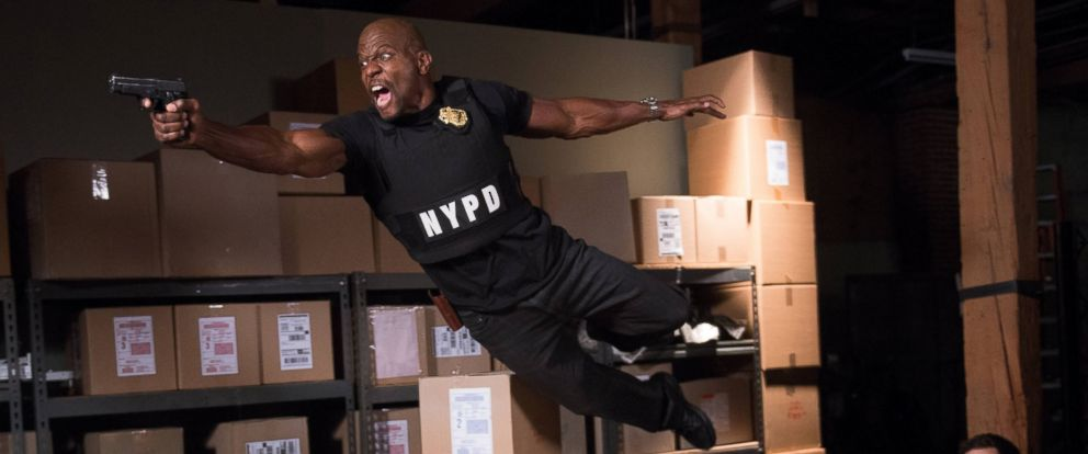 "PHOTO: Terry Crews and Andy Samberg in the ""Ebony Falcon"" episode of Brooklyn Nine-Nine, Jan. 21, 2014."