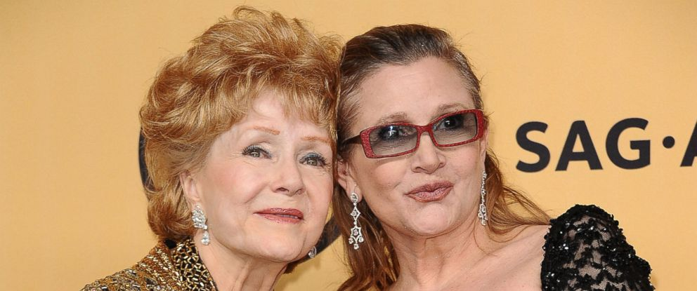PHOTO: Debbie Reynolds and Carrie Fisher pose in the press room at the 21st annual Screen Actors Guild Awards at The Shrine Auditorium, Jan. 25, 2015, in Los Angeles.