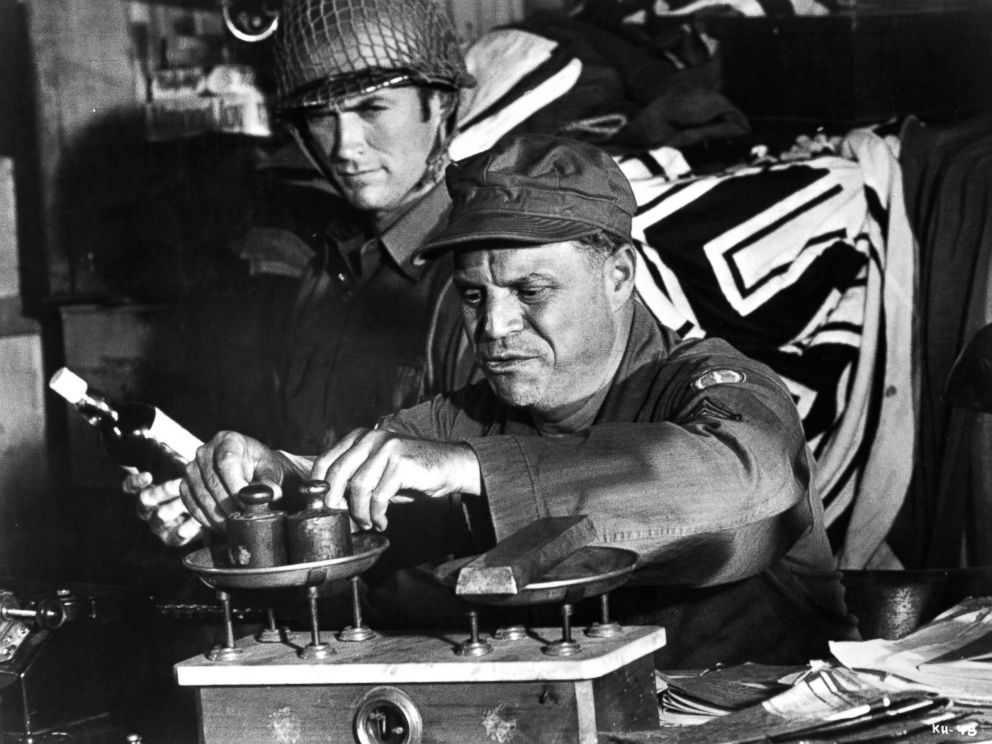 PHOTO: Clint Eastwood watches as Don Rickles weighs his captured ingots in a scene from the film Kellys Heroes, 1970.