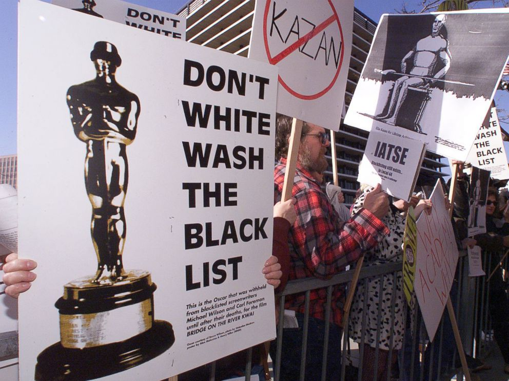 PHOTO: People demonstrate against the Lifetime Achievement Award that was presented to film director Elia Kazan, March 21, 1999.