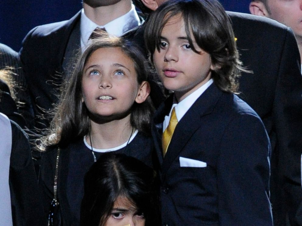 PHOTO: Paris Jackson, left, Prince Michael Jackson II, center, and Prince Michael Jackson I, children of Michael Jackson, stand on stage during the memorial service for their father at the Staples Center in Los Angeles, on July 7, 2009.