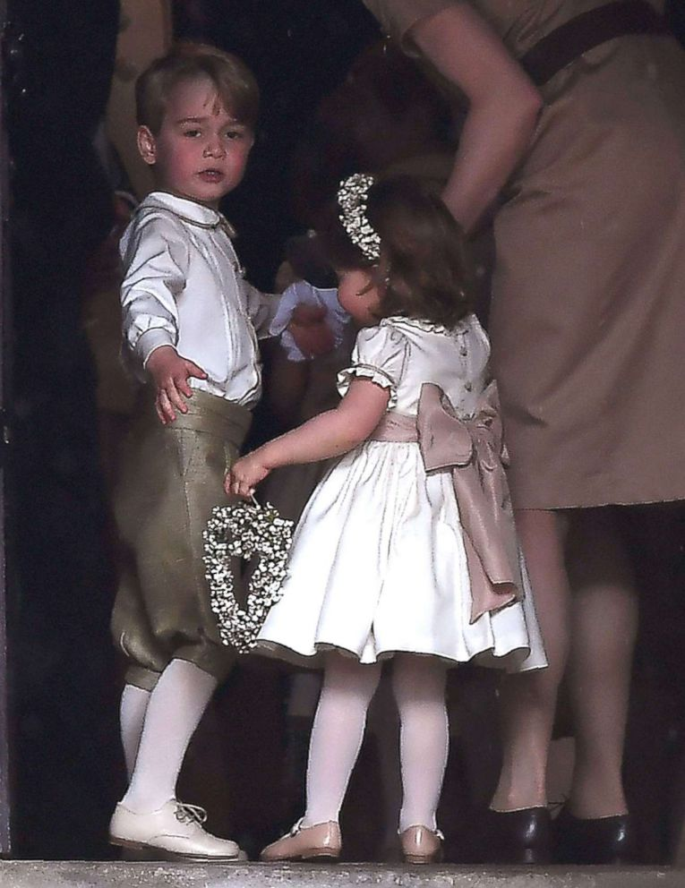 PHOTO: Britains prince George, a pageboy, and princess Charlotte, a bridesmaid, stand with their nanny as they attend the wedding of their aunt Pippa Middleton to James Matthews at St Marks Church in Englefield, west of London, May 20, 2017.
