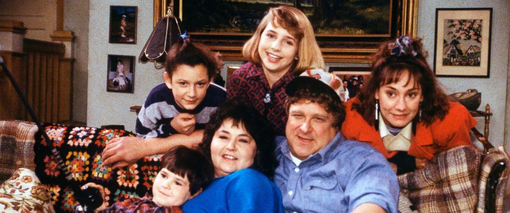 "PHOTO: Roseanne (Roseanne Barr), Dan (John Goodman) Darlene (Sara Gilbert, top left) Becky (Lecy Goranson, top center) on the ""Roseanne"" show."
