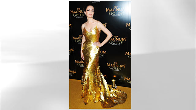 """PHOTO: Actress Caroline Correa (wearing Zac Posen's one of a kind 24k gold dress) attends the screening of """"As Good As Gold"""" during the 2013 Tribeca Film Festival at Gotham Hall, April 18, 2013 in New York City."""