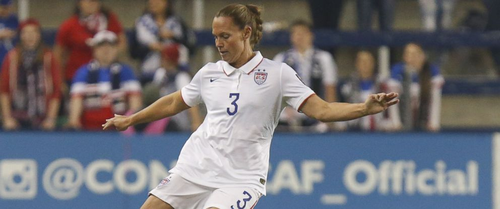 PHOTO: Christine Rampone of United States drives the ball up field against the Trinidad & Tobago in the first half of the CONCACAF Womens Championship USA 2014 on October 15, 2014 at Sporting Park in Kansas City, Kansas.