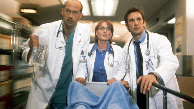 """PHOTO: Anthony Edwards, Laura Innes and Noah Wyle act in scene in NBC's primetime drama series """"ER"""", 2001."""