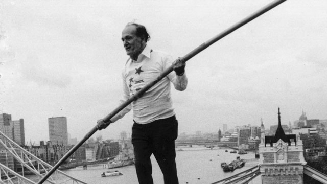 PHOTO: Karl Wallenda walks a tightrope from two corners of the Tower Hotel with Tower Bridge in the background, Nov. 23, 1976.