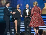 """PHOTO: Singers Jennifer Lopez, Pitbull present Adele the Best Pop Solo Performance for """"Set Fire to the Rain (Live)"""" onstage while Vitalii Seduik tries to crash the stage at the 55th Annual Grammy Awards at Staples Center on Feb. 10, 2013 in Los Angeles."""