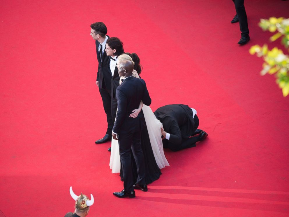 PHOTO: A man invades the Red Carpet as Jay Baruchel, Kit Harington, America Ferrera, Cate Blanchett and Djimon Hounsou pose at the How To Train Your Dragon 2 premiere during the 67th Annual Cannes Film Festival on May 16, 2014 in Cannes, France.