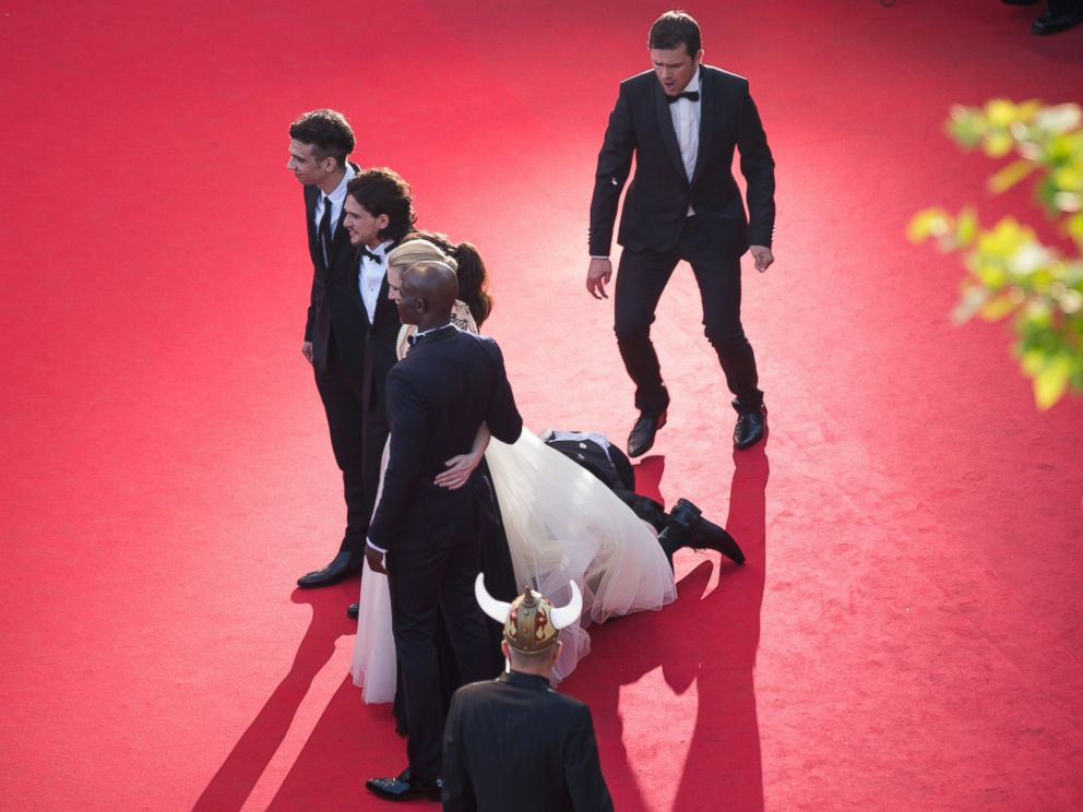 PHOTO: A man invades the Red Carpet as Jay Baruchel, Kit Harington, America Ferrera, Cate Blanchett and Djimon Hounsou pose at the How To Train Your Dragon 2 premiere during the Cannes Film Festival on May 16, 2014 in Cannes, France.