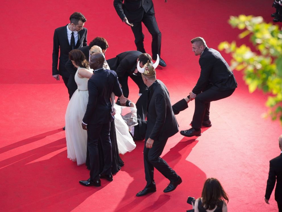 PHOTO: A man is held by security at the How To Train Your Dragon 2 premiere during the 67th Annual Cannes Film Festival on May 16, 2014 in Cannes, France.