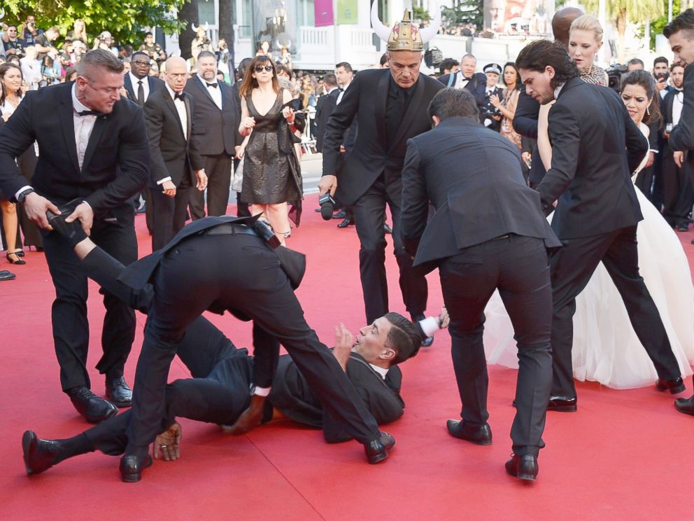 PHOTO: A man is held by security after invading the read carpet at the How To Train Your Dragon 2 premiere during the 67th Annual Cannes Film Festival on May 16, 2014 in Cannes, France.