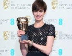 PHOTO: Anne Hathaway poses in the Press Room at the EE British Academy Film Awards at The Royal Opera House, Feb. 10, 2013, in London.