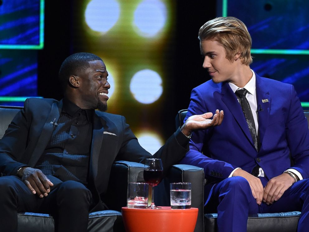 PHOTO: Roastmaster Kevin Hart and Justin Bieber onstage at The Comedy Central Roast of Justin Bieber on March 14, 2015 in Los Angeles.