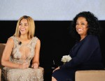 """PHOTO: Beyonce and Oprah Winfrey speak onstage at the HBO Documentary Film """"Beyonce: Life Is But A Dream"""" New York Premiere at the Ziegfeld Theater on February 12, 2013 in New York City."""